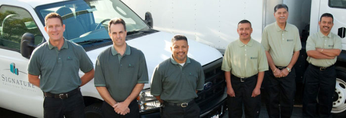 Signature Facilities Services hires Professionals in all aspects of building maintenance. Image of workers.